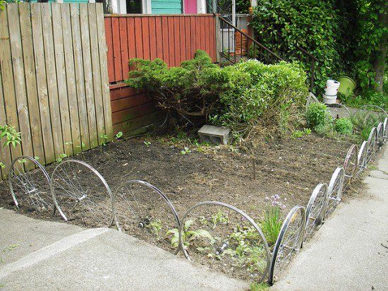 Garden Edge Ideas find this pin and more on garden edging ideas Metal Wheels